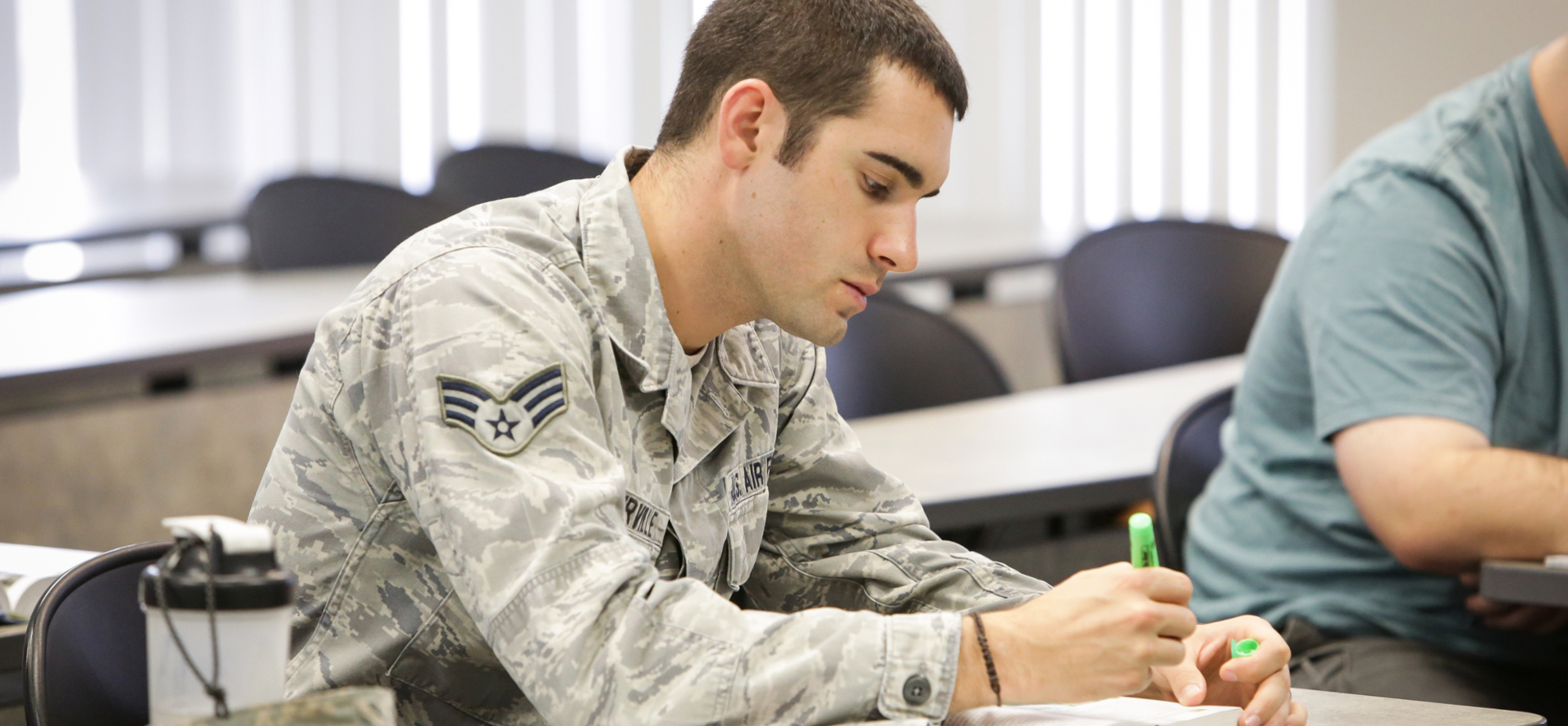 Military student testing in classroom